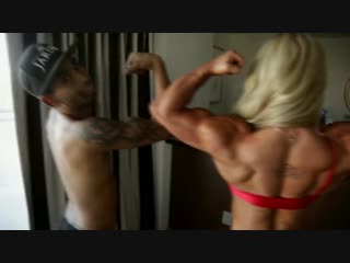 Muscle_girl_compares_with_small_guy