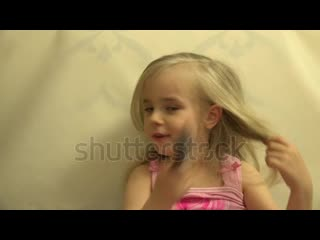 Stock-footage-girl-toddler-child-hair-dresses-herself-with-a-hair-comb-and-brush