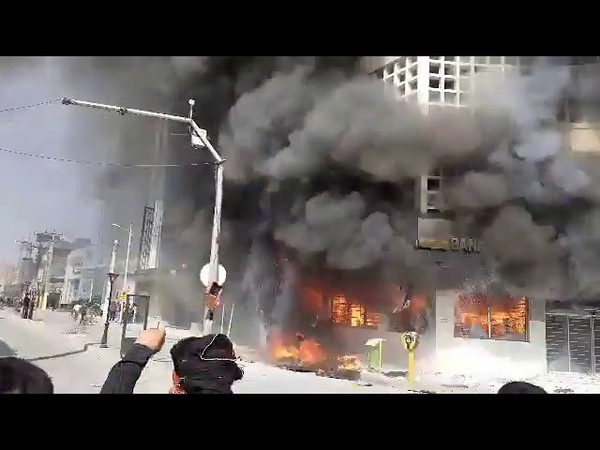Chants of Death to Khamenei as Irans Bank Melli burns on Day 2 of IranProtests in Behbahan. Nati