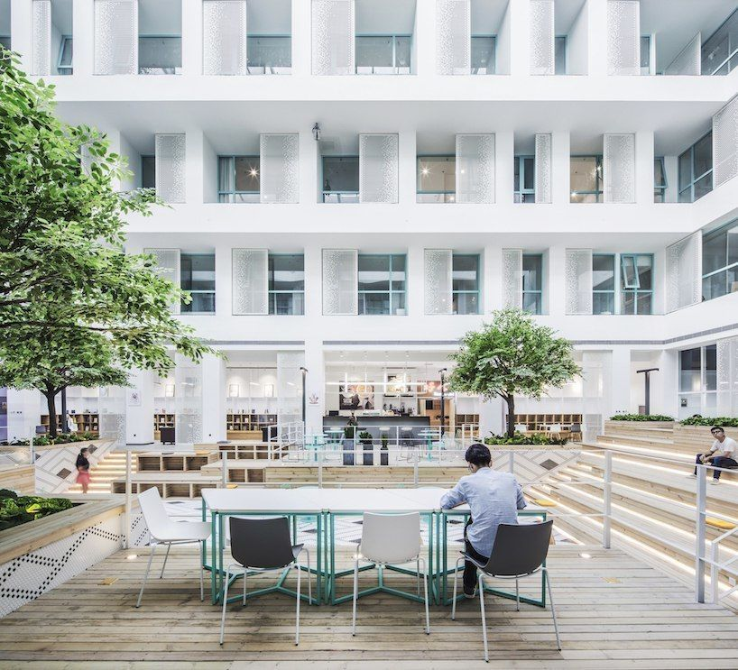 MAT office's beijing apartment complex and co-working space features a 16 meter-high atrium