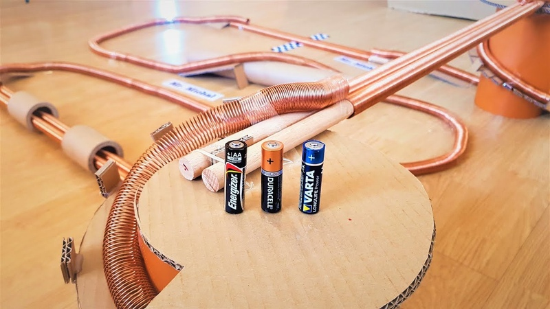 Simplest Electromagnetic Train Race between AA Batteries And DIY Simple Electric Train