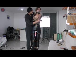 plug gagged asian catsuit bondage