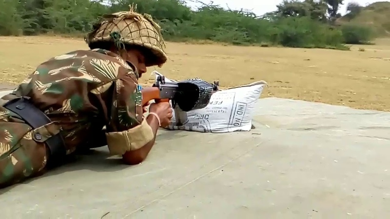 Shooting with INSAS rifle in Army Attachment Camp, NCC