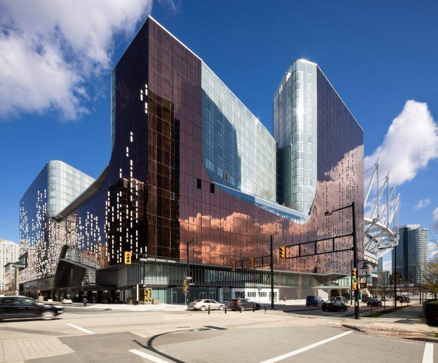 Canadian firms ACDF Architecture and Architecture49 have created a shiny hotel and entertainment complex for an irregularly shaped property that borders BC Place Stadium in Vancouver.