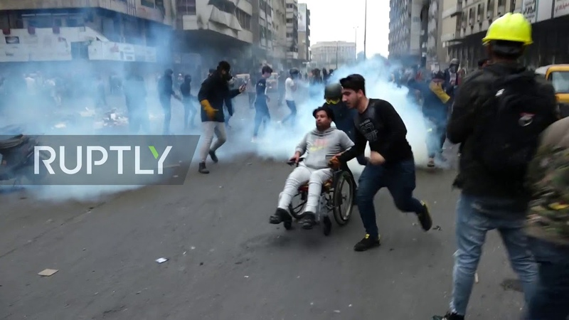 Iraq Police fire tear gas at anti government protesters in Baghdad