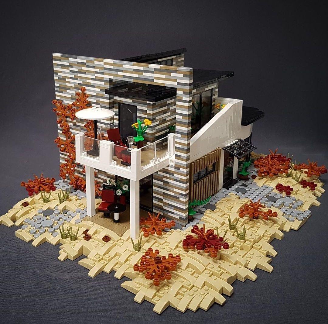Проект современного дома в окружении песчаных дюн.