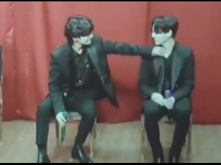 TAEHYUNG WAS FIXING JUNGKOOKS CLOTHES THEN HE RUBBED HIS CHEST AND JUNGKOOK WAS SMILING AND BEING SO SHY OMFG